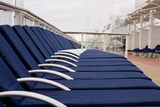 Free Row Of Blue Chaises Under Clouds Royalty Free Stock Photo - 8240345