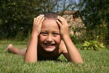 Boy In Green Grass Royalty Free Stock Photo