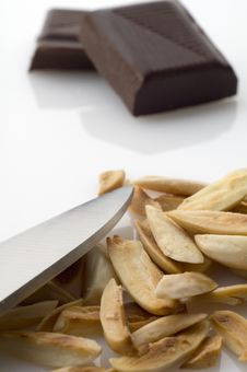 Free Knife And Split Roasted Almonds With Chocolate Stock Photos - 8242323