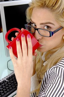 Side Pose Of Woman Drinking Coffee Stock Photography