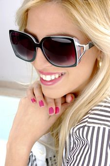 Free Side View Of Smiling Blonde Female Stock Image - 8243991