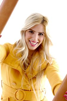 Front View Of Smiling Model Holding Frame Stock Images