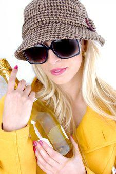 Free Fashionable Woman Holding Wine Bottle Stock Photography - 8244062