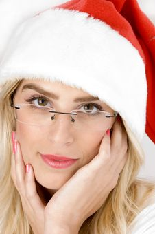 Woman In Christmas Hat Looking At Camera Royalty Free Stock Photography