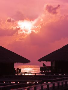 Free Human Silhouette In Water Bungalow At Sunset Stock Images - 8244204