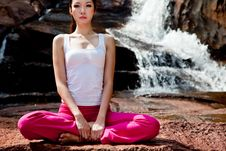 Young Woman Relaxing By The Waterfall Royalty Free Stock Images