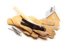 Hammer, Gloves, Nails And House Stock Images