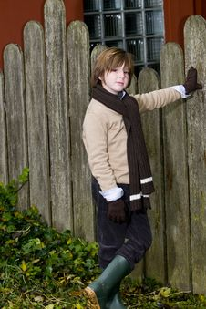 Free Cute Autumn Boy Near Fence Royalty Free Stock Images - 8245819