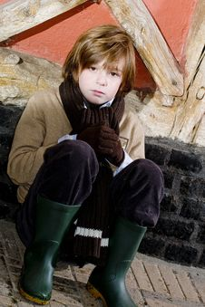 Free Cute Autumn Boy Near Cottage Stock Images - 8245914
