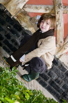 Free Cute Autumn Boy Near Cottage Stock Photo - 8246040