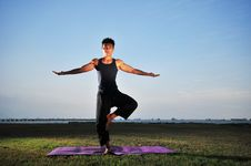 Yoga By The Beach Royalty Free Stock Photography