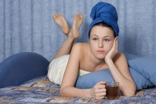 Girl In Dark Blue Towel With Cup In Hand Stock Photo
