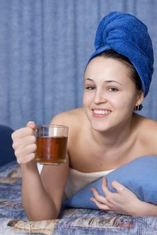 Girl In Dark Blue Towel With Cup In Hand Stock Photos