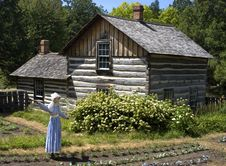Free Scarecrow In Farm Garden And Log Cabin Stock Images - 8254604