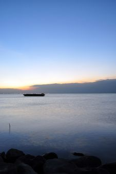 Free A Lone Barge And Sunset Stock Photography - 8255572