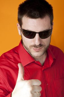 Free Man With Sunglasses Showing Thumbs Up Stock Photo - 8257270