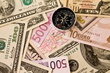Background From Money And Compass Royalty Free Stock Photos