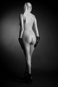 Blond Girl In Black Gloves Stock Photos