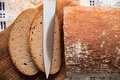 Free Pieces Of Bread On Breadboard With Knife. Royalty Free Stock Photos - 8269338