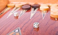 Ivory Dices On Wooden Handmade Backgammon Board Stock Images