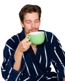 Free Young Man In Bathrobe Drinks Tea Isolated Stock Images - 8260944