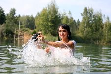 Photographer In Water Stock Photo