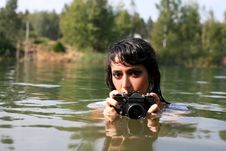 Free Photographer In Water Royalty Free Stock Photography - 8262037