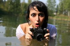Photographer In Water Stock Images