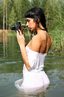 Photographer In Water Royalty Free Stock Image