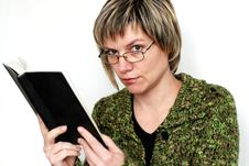 Free Reading Woman In Glasses Stock Image - 8266781