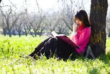 Free Enjoying A Book In The Forest Stock Photos - 8268873