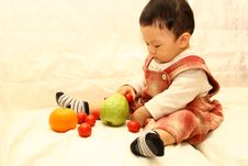 Free Child With Fruits(Tomato,orange And Guava) Royalty Free Stock Photography - 8269537