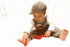 Free Cute Child Playing Tomato Stock Photos - 8269583