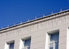 Free Icicles On The Roof Of Building-1 Royalty Free Stock Photography - 8269737