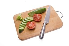 Free Cucumber And Tomato And The Board. Royalty Free Stock Photography - 8270977