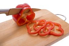 Free Sliced Red Pepper On A Board. Royalty Free Stock Photos - 8271108
