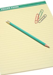 Free Pencil On A Yellow Notebook. Stock Photos - 8272853
