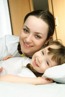 Mother And Daughter In Bed Royalty Free Stock Image