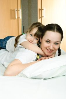 Mother And Daughter On The Bed Stock Photo