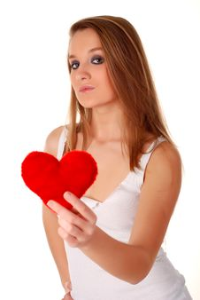 Woman And Artificial Red Heart Royalty Free Stock Image