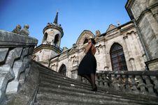 Free Brunette Beside Castle Stock Photography - 8274822