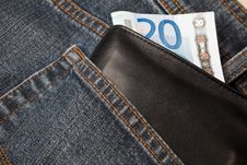 Denim Jeans With A Wallet And A Twenty Euro Note Royalty Free Stock Photo