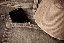 Free Grunge Jeans With A Mobile Phone And Baseball Cap Royalty Free Stock Image - 8275196