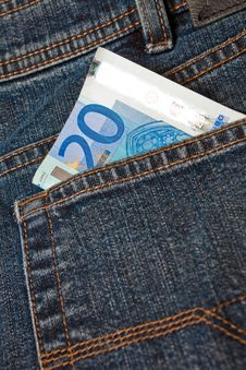 Blue Denim Jeans With A Twenty Euro Note Stock Images