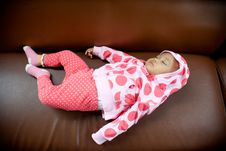 Baby Sleeping On A Sofa Stock Photos