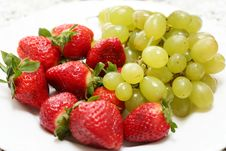 Grape And Strawberry Stock Images