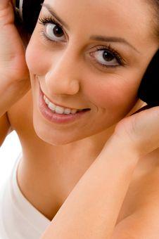 Free Top View Of Smiling Woman Enjoying Music Stock Images - 8276244