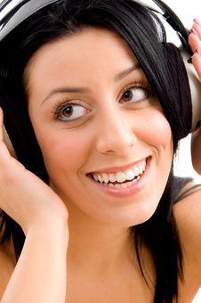 Free Close Up Of Smiling Female Enjoying Music Stock Images - 8276314