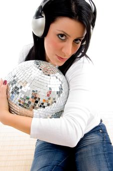 Female Listening Music And Holding Disco Ball Royalty Free Stock Photography