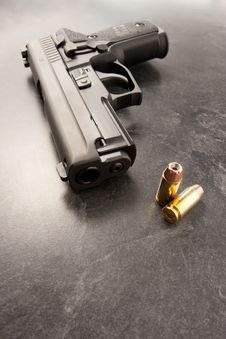Free Handgun And Bullets Stock Photography - 8276832